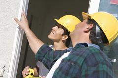 Construction Workers Checking Window Stock Photos