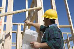 Male Architect Inspecting At Construction Site Stock Photos