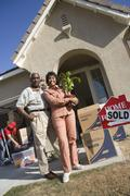 Stock Photo of Couple Moving To Their New House