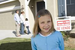 Girl With Family On Front Of House For Sale - stock photo