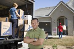 Man In Front Of Delivery Van And House - stock photo