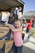 Girl By Trunk Of Cardboard Boxes Stock Photos