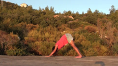 Yoga for pregnant triangle and leg-stretch Stock Footage