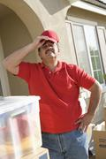 Tired Mature Delivery Man - stock photo