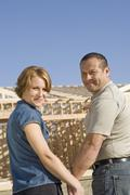 Couple In Front Of House Under Construction - stock photo