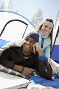 Stock Photo of Couple Relaxing On A Camping Trip