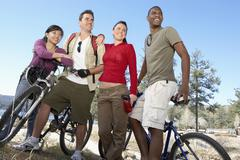 Young Friends With Mountain Bikes By The lake - stock photo