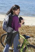 Woman With Binoculars At The Beach - stock photo