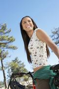 Female With Bicycle Looking Away Stock Photos