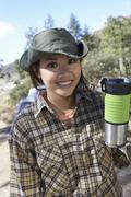 Stock Photo of Female Holding Thermos