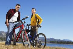 Caucasian Couple Standing With Their Bicycles - stock photo