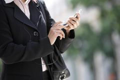 Business Woman Dialing On Cell Phone - stock photo