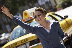 Businesswoman Hailing Cab - stock photo