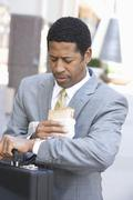 Stock Photo of Businessman Checking Time