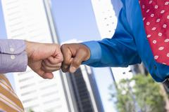 Two Hands Punching Fists Stock Photos