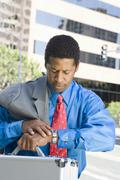 Businessman Checking Time - stock photo