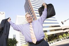 Stock Photo of Businessman With Arm Raised