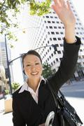 Happy Business Woman Waving Hand - stock photo