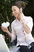 Stock Photo of Business Woman Communicating On Cell Phone