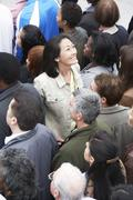 Chinese Woman Facing The Other Direction From The Multiethnic Crowd - stock photo