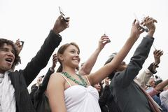 Stock Photo of People Holding Mobile Phone