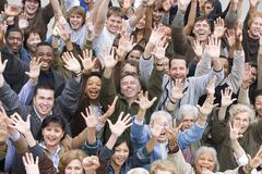 Multi Ethnic People Raising Hands Together - stock photo