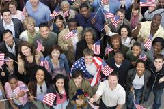 People Together Raising American Flag - stock photo