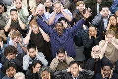 Man Raising Hands While People Covering Their Ears Stock Photos