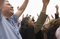 People With Raised Hands In Rally Stock Photos