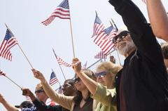People Holding American Flag During A Rally - stock photo