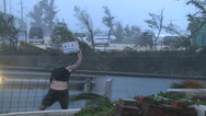 Stock Video Footage of Hurricane Violent Winds Lash Scientist Flying Debris