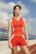 Athlete Woman Standing On Racetrack Stock Photos