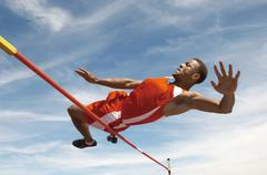 High Jumper In Midair Over Bar - stock photo