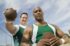 Male Athletes With Shot Put And Discus Stock Photos