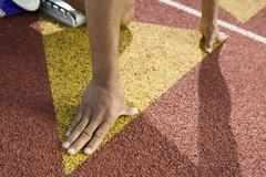 Stock Photo of Runner Positioned On Starting Block