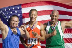 Relay Team With Flag And Medal Stock Photos