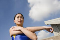 Stock Photo of Athlete Stretching Arm