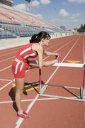 Stock Photo of Female Athlete Stretching Leg