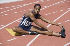 Woman Stretching On Race Track Stock Photos