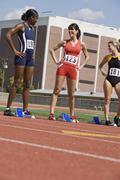 Female Athletes At Starting Blocks - stock photo