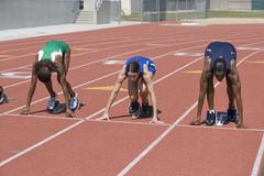 Stock Photo of Female Athletes At Starting Line On Race Track