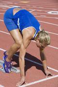 Stock Photo of Female Runner At Starting Line