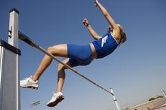 Athlete Performing High Jump - stock photo