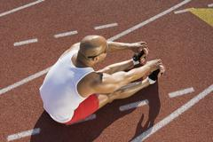 Stock Photo of Male Athlete Working Out Before Race