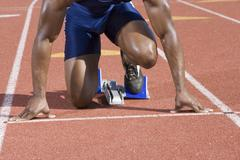 Male Runner At Starting Block - stock photo