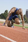 Male Runner In The Start Up Position - stock photo