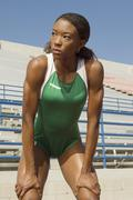 Female Athlete Standing With Hands On Knees Stock Photos