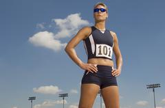 Confident Female Athlete Looking Away - stock photo