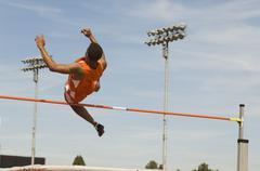 Athlete Performing High Jump Stock Photos