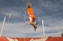 Stock Photo of Male Athlete Pole Vaulting